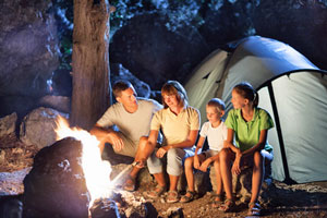A family sitting around a campfire